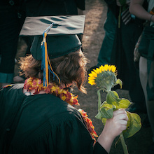 Graduate with flower